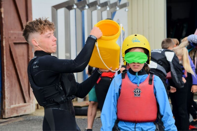 UKSA instructor tipping water over a child's head