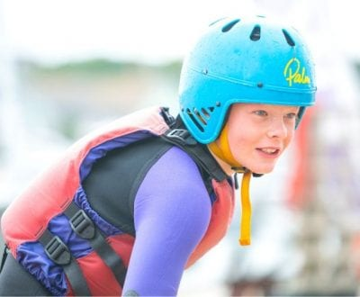 A young female student with a blue helmet on
