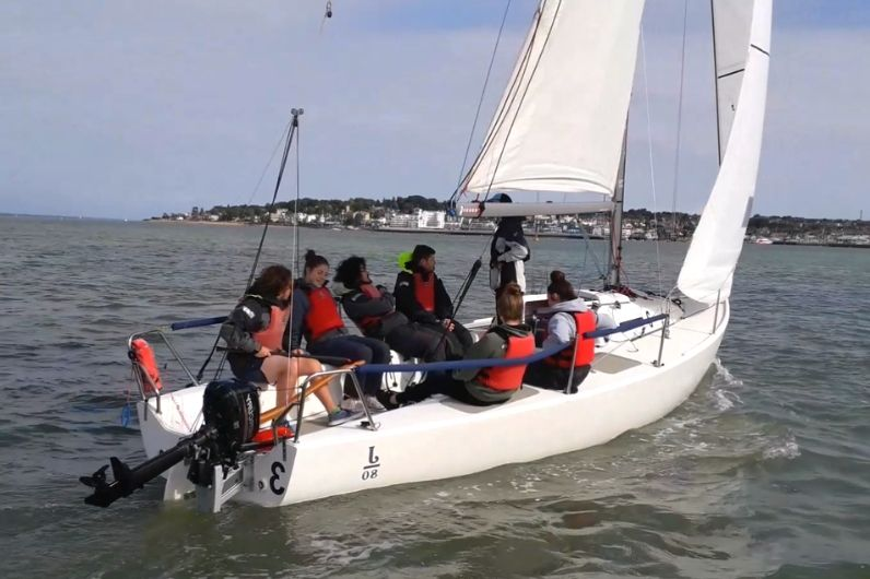 A group of young people onboard a keel board