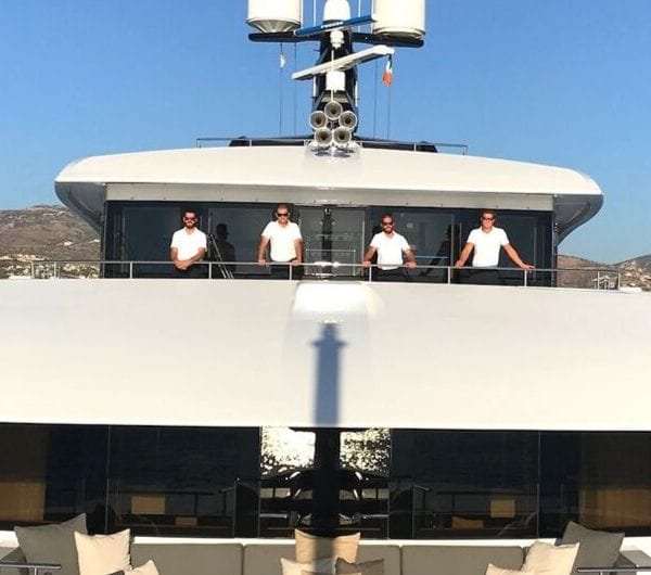 A group shot of superyacht crew onboard a superyacht