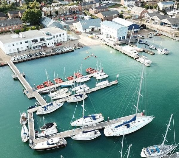 UKSA sailing yachts assembling in harbour