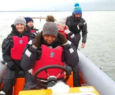Teachers in a power boat experiencing driving first hand