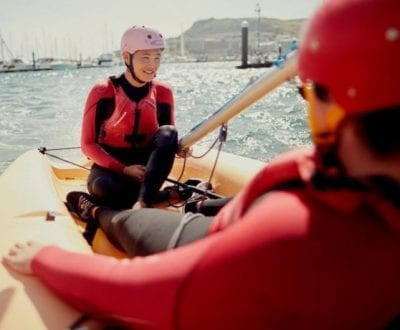 Further education students onboard a dinghy
