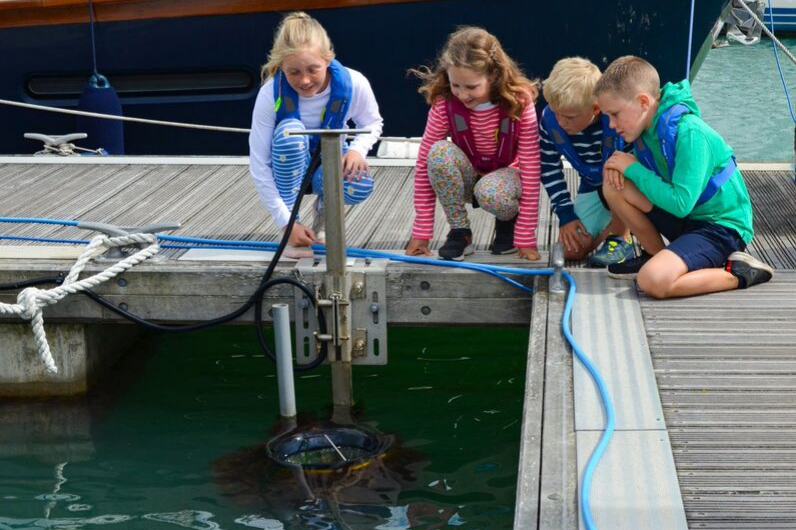 Children admiring the SeaBin