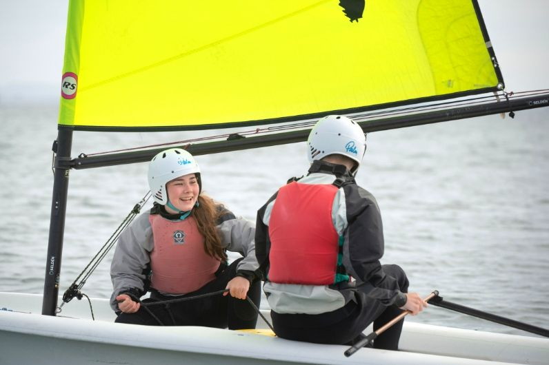 Two students having fun in a dinghy
