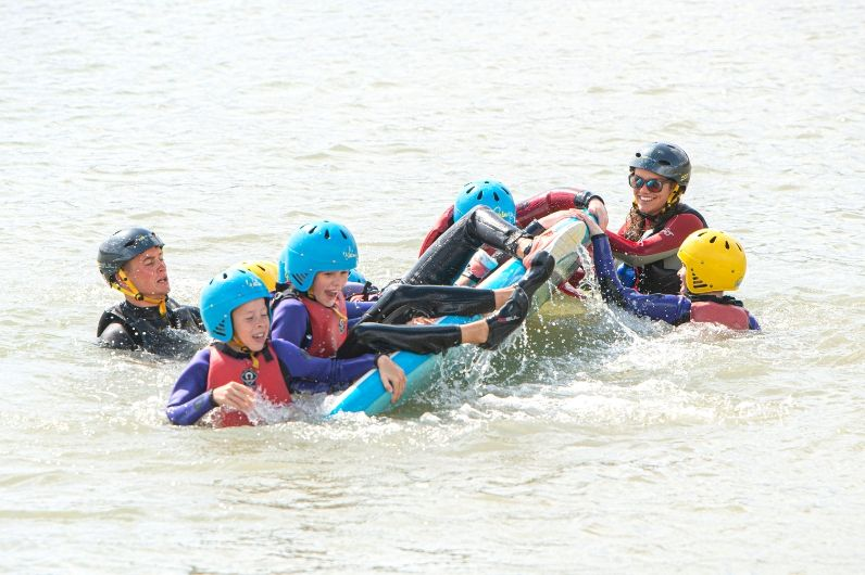 Children enjoying a UKSA watersports group challenge.