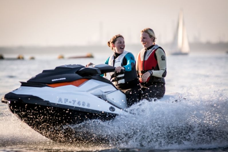 Two students having fun on a jet-ski