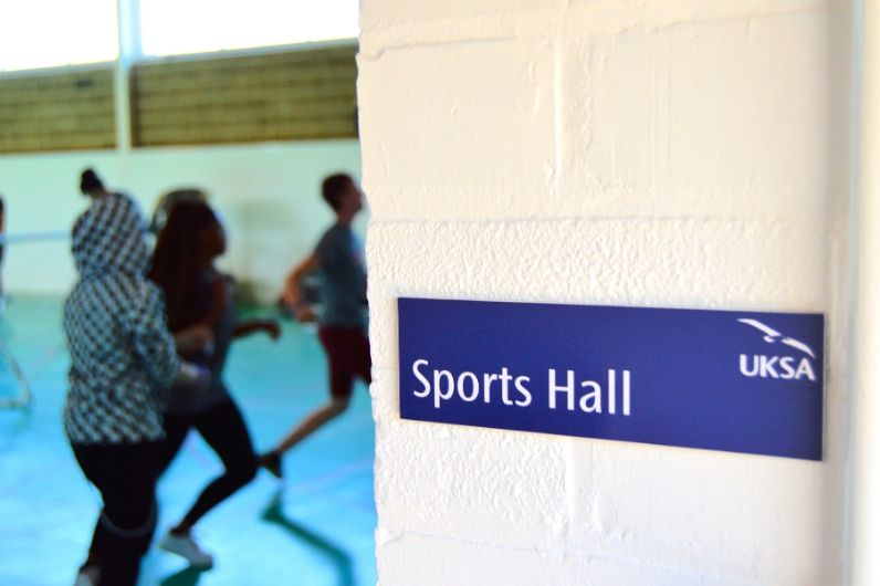The UKSA sports hall sign in the entrance doorway