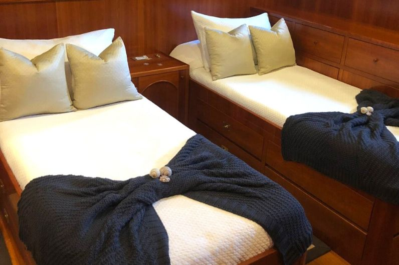 Two beds that have been professionally prepared onboard a superyacht