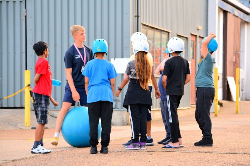 A group of young children with a UKSA instructor