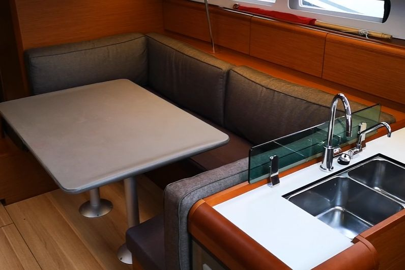 The seating area inside of a yacht
