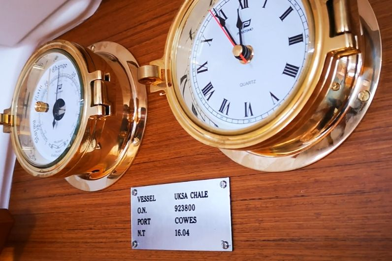A close up of clocks onboard a yacht