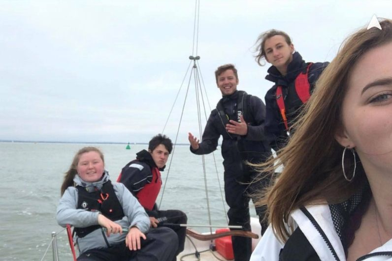 Susie Greatorex taking a selfie with fellow watersports students