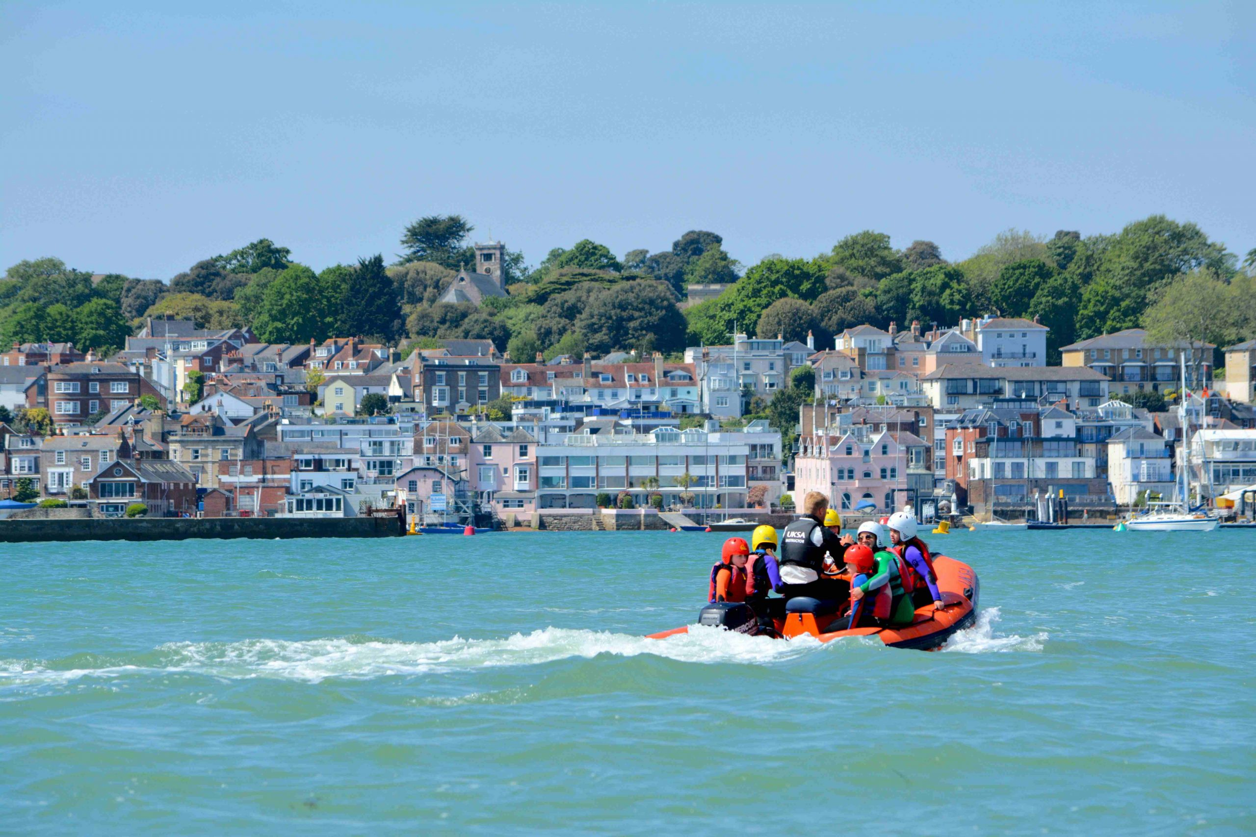 A powerboat with children on the Solent in Cowes