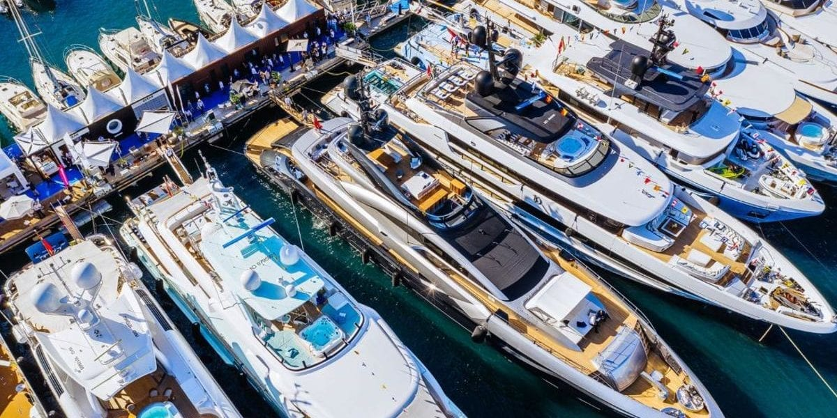 A line of Superyachts in a dock