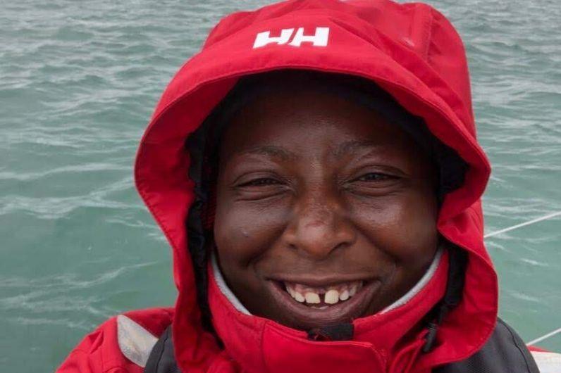Lungi Mchunu smiling at the camera