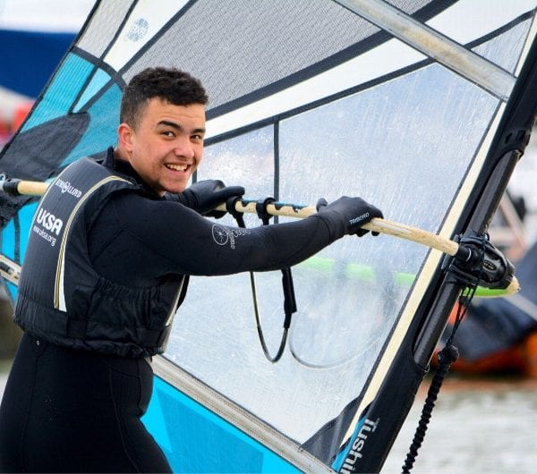 A young male learning to windsurf