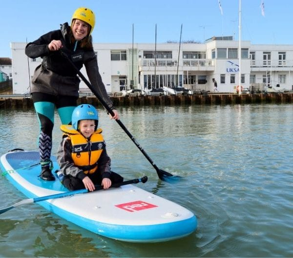 A young woman with her child at UKSA paddleboarding