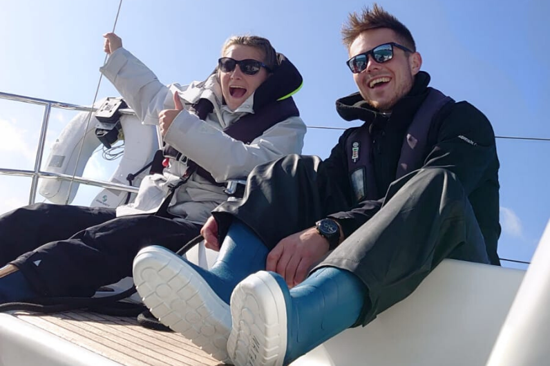 Katie Sewell with a fellow student onboard a yacht