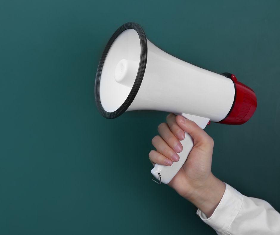 A hand holding a megaphone