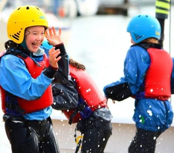 Children having fun with water splashing