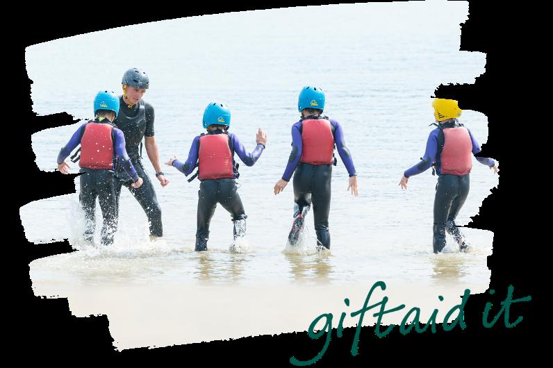 Kids running into the sea