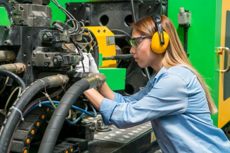A young female working on a ships engine