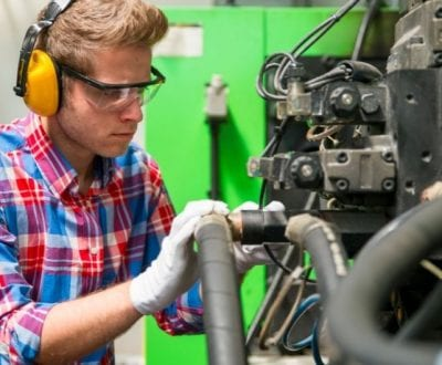 A young male working on an engine
