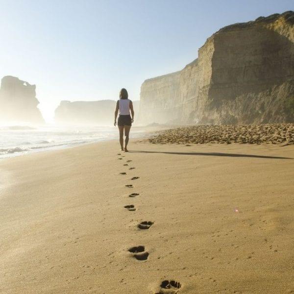 A woman walking on the beach