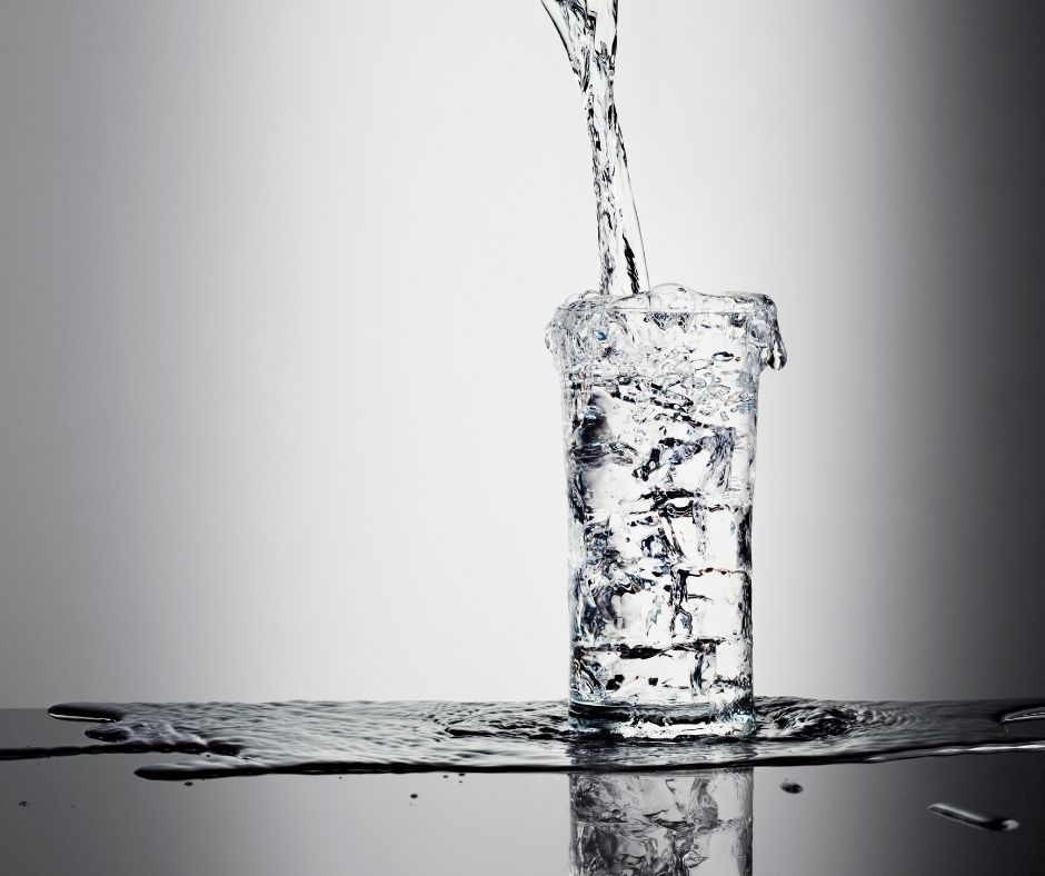 A glass overflowing with water