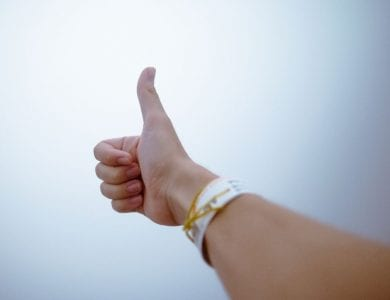 Persons arm with a thumbs up